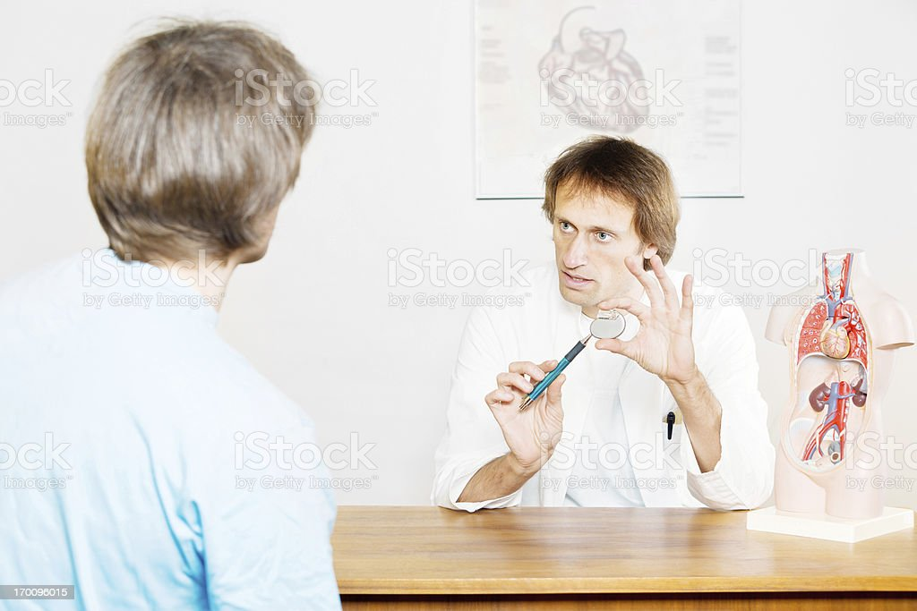 Doctor explaining cardiac pacemaker. stock photo