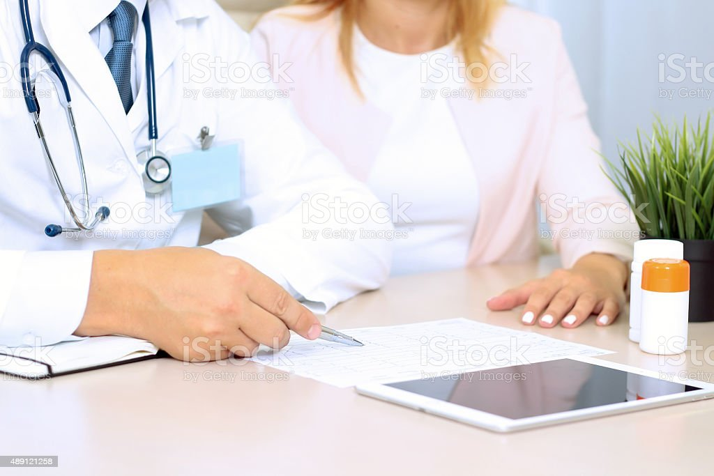 doctor explaining diagnosis to female patient stock photo