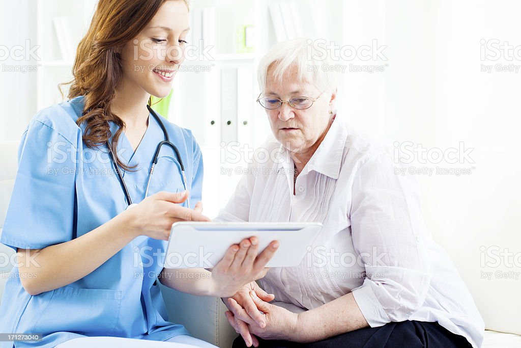Doctor Explaining Medical Exam Results to senior patient. royalty-free stock photo