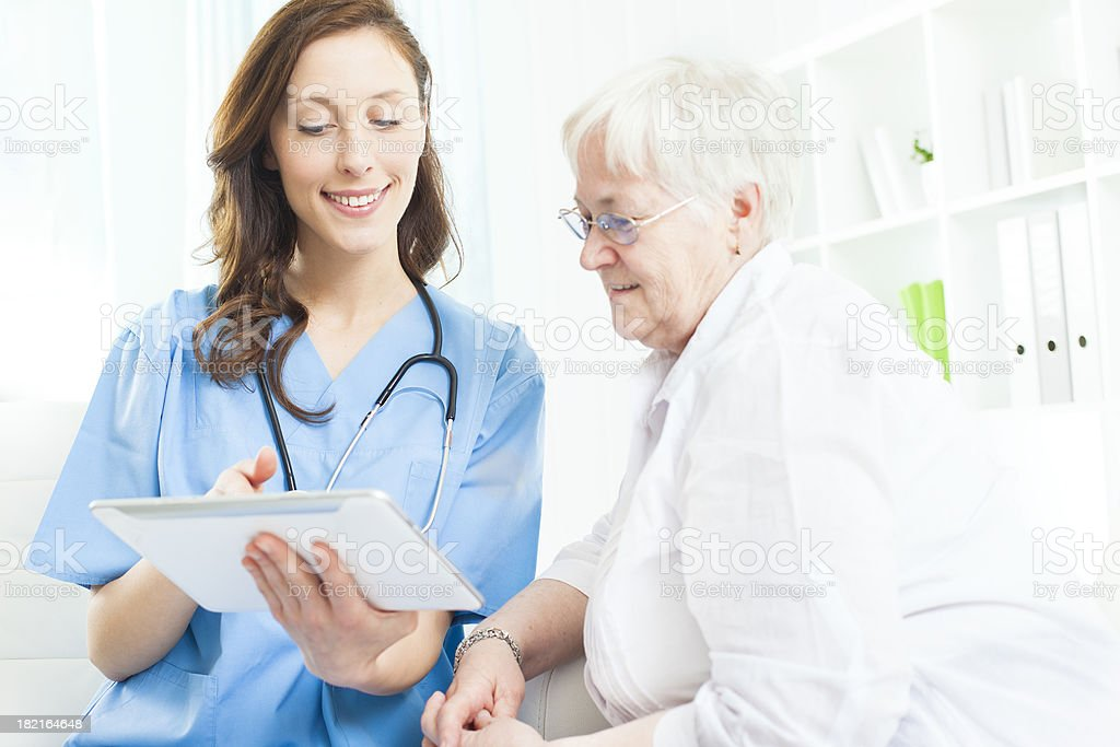 Doctor Explaining Medical Exam Results to senior patient. stock photo