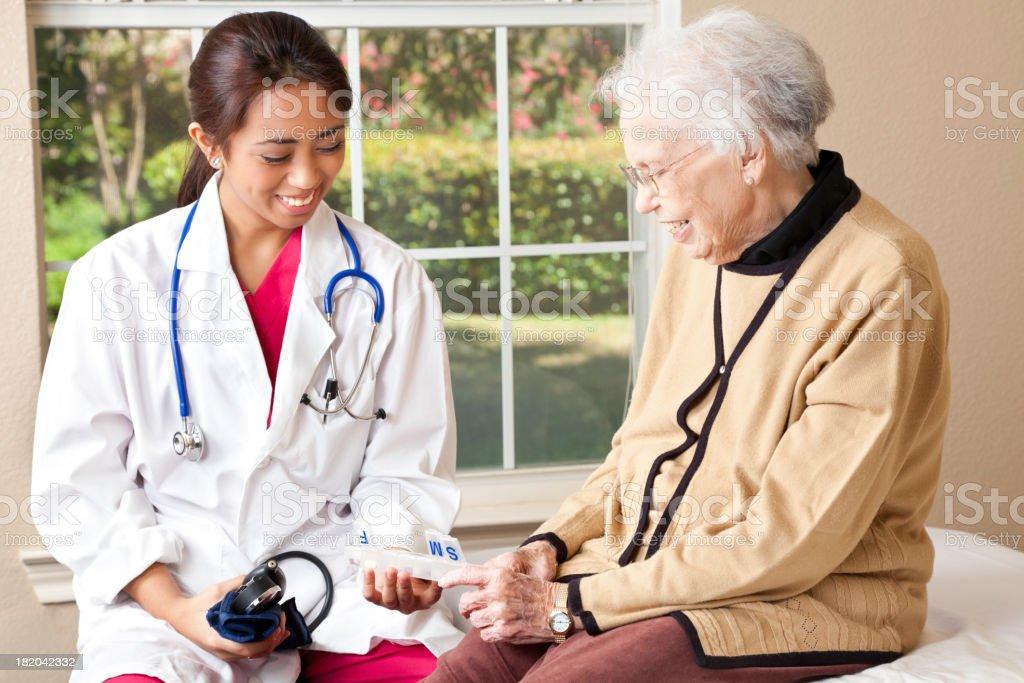 Doctor Explaining Medication To Senior Adult Patient royalty-free stock photo