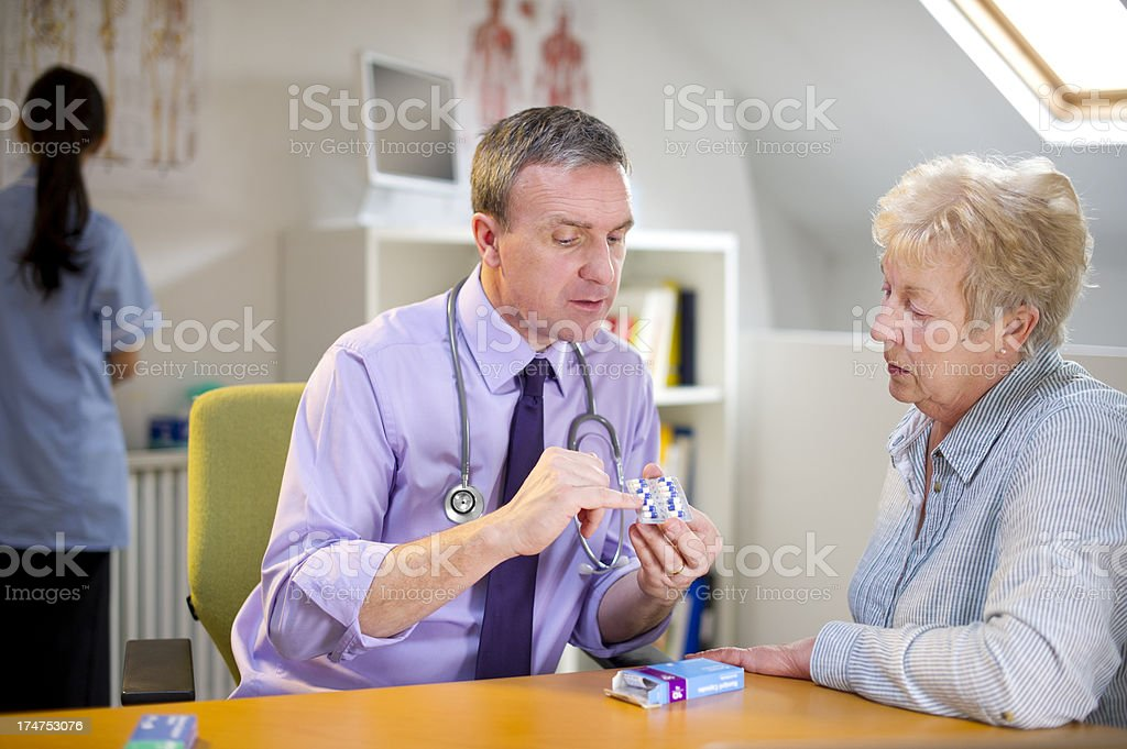 doctor explaining medicines to patient royalty-free stock photo