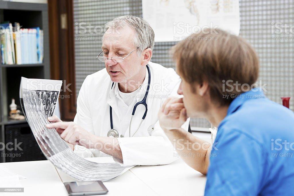 Doctor explaining MRI images stock photo