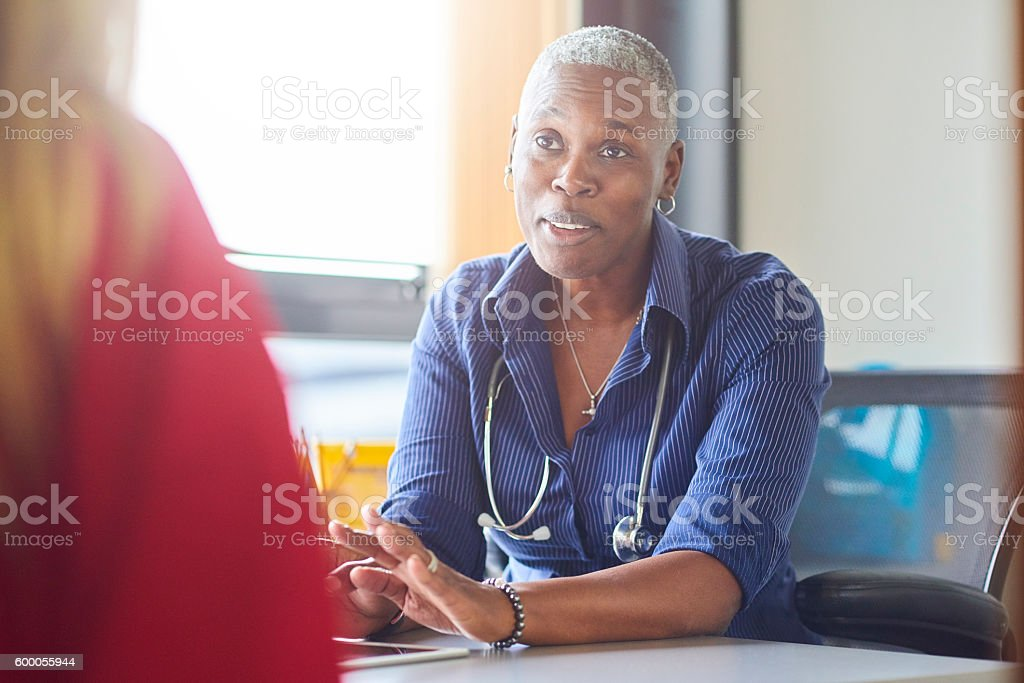 Doctor explaining results stock photo