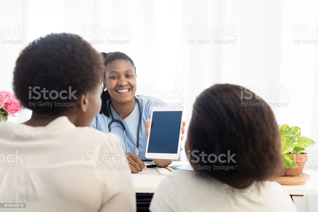 Doctor Explaining Test Results To Her Patient stock photo