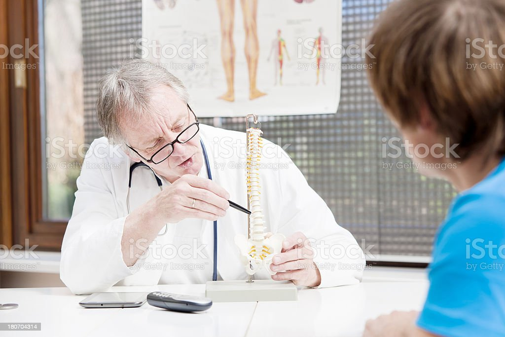 Doctor explaining the human spine stock photo
