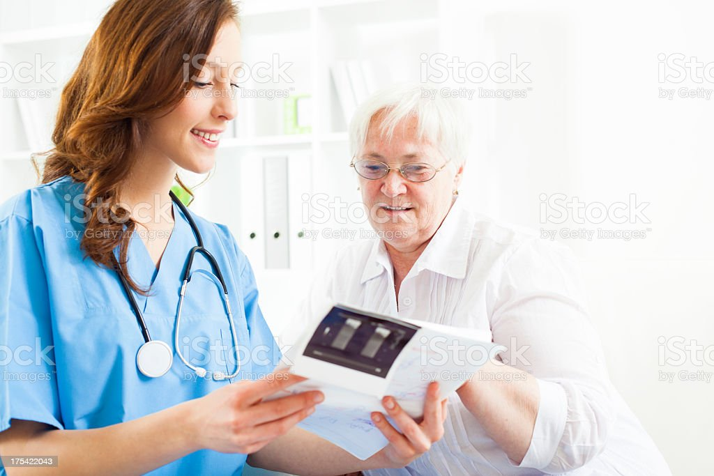 Doctor Explaining Ultrasound Image to senior patient. stock photo