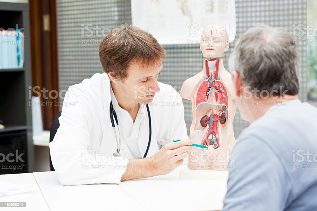 Doctor explaining urological problems stock photo