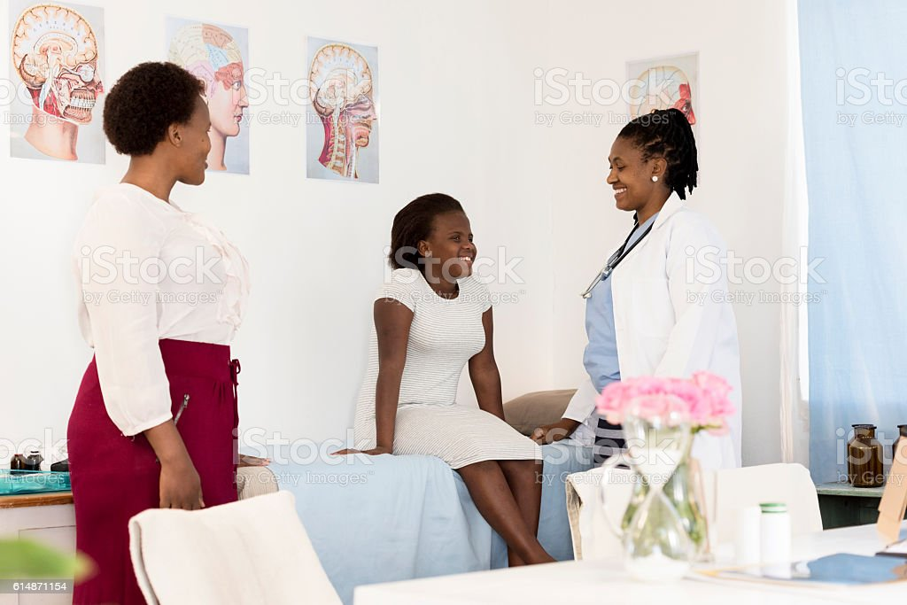 Doctor & Female Patient In Her Consultation Room stock photo