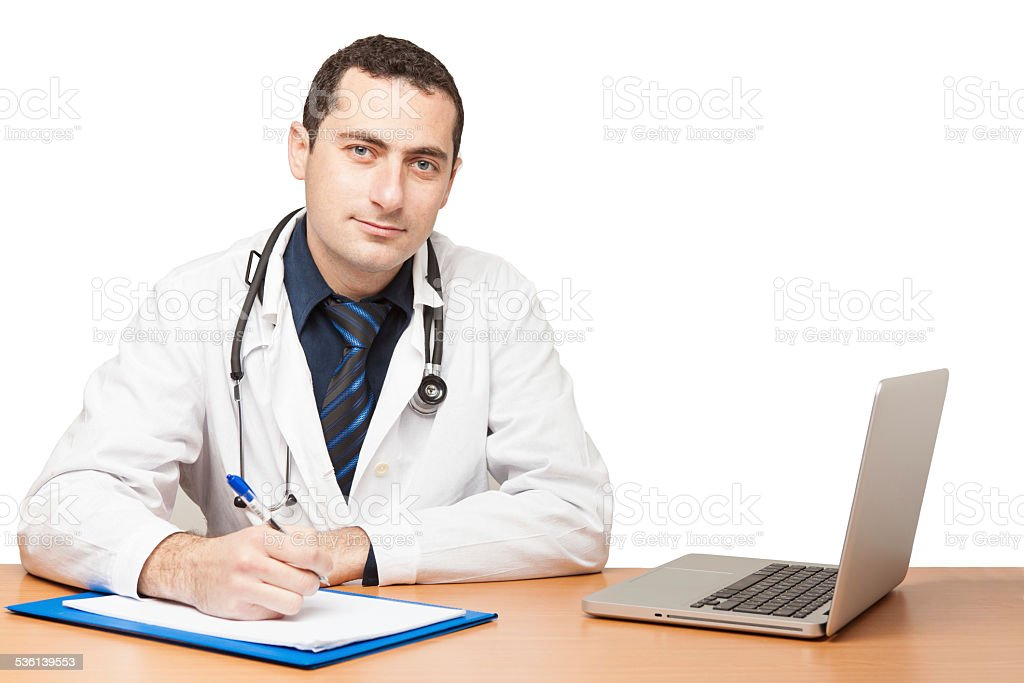 Doctor filling out medical document stock photo