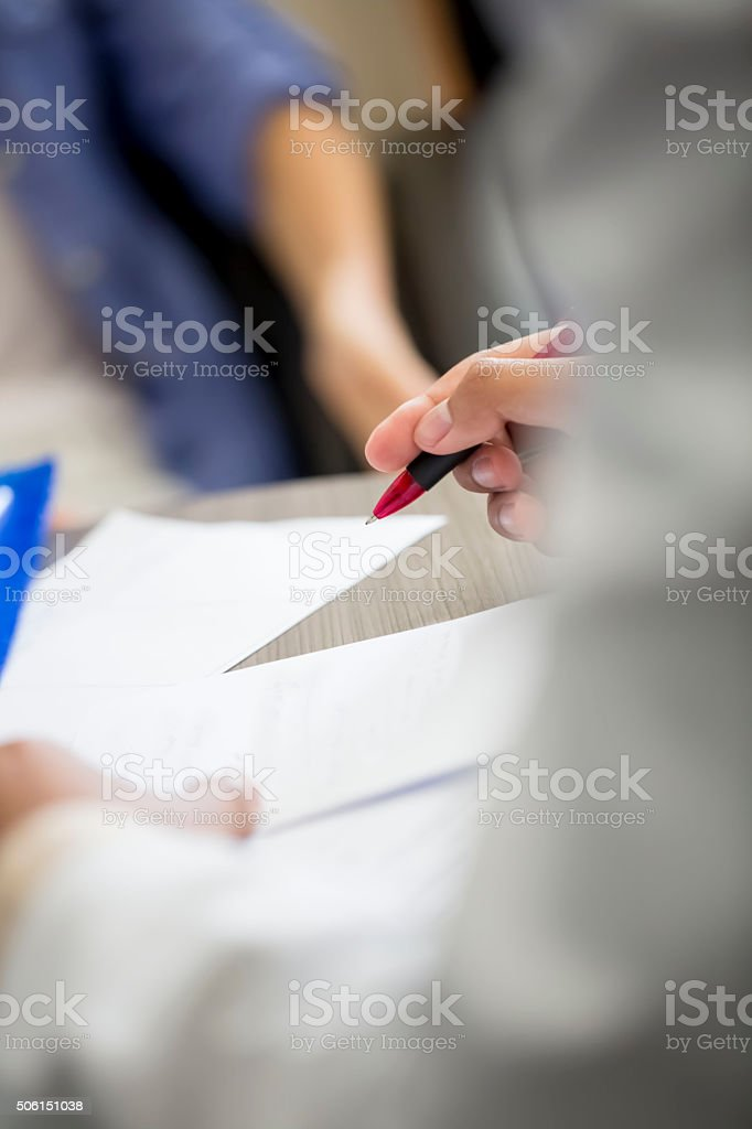 Doctor filling out prescription stock photo