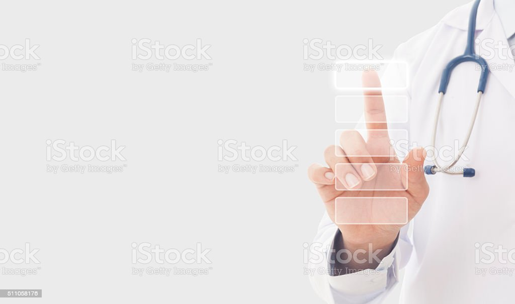 Doctor Finger pressing push button on a touch screen interface stock photo