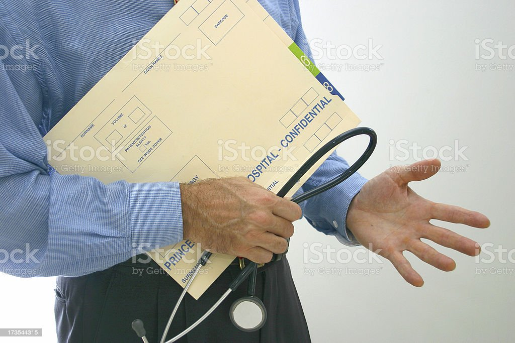 doctor gesticulates stock photo