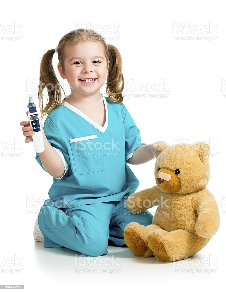 doctor girl playing and measuring  temperature plush toy isolated on stock photo