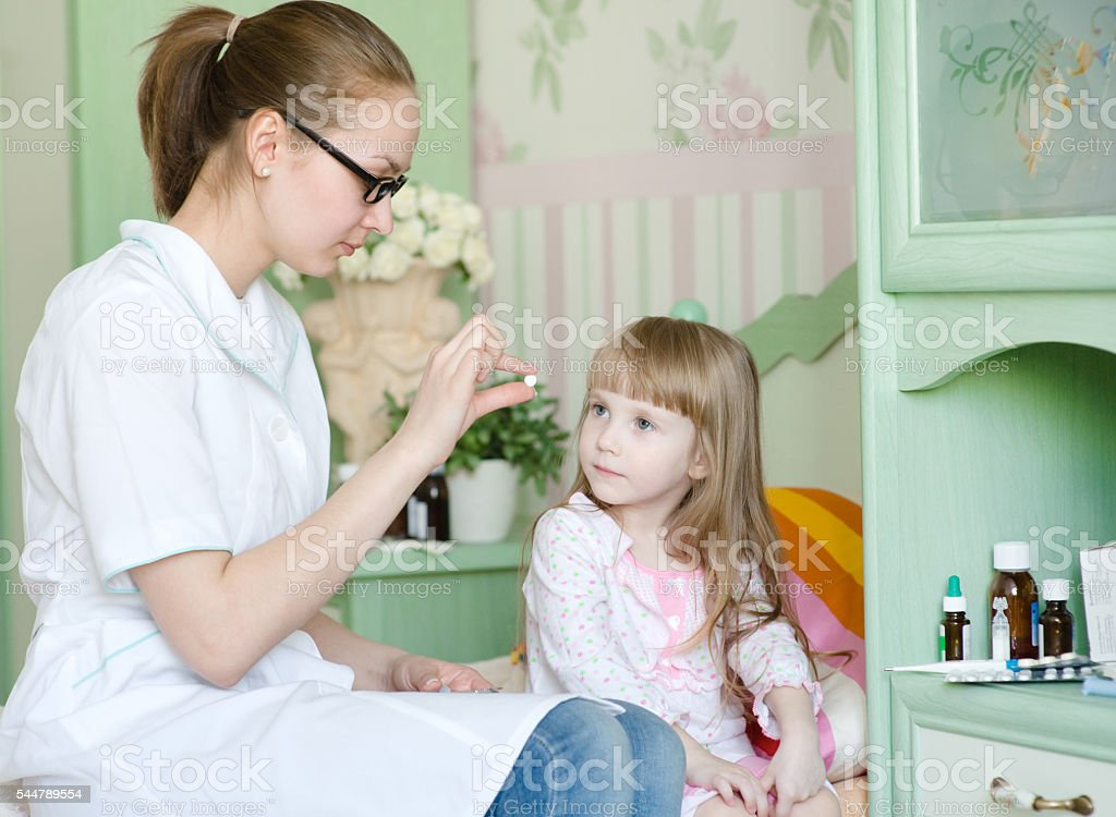 doctor gives a drug to the child stock photo