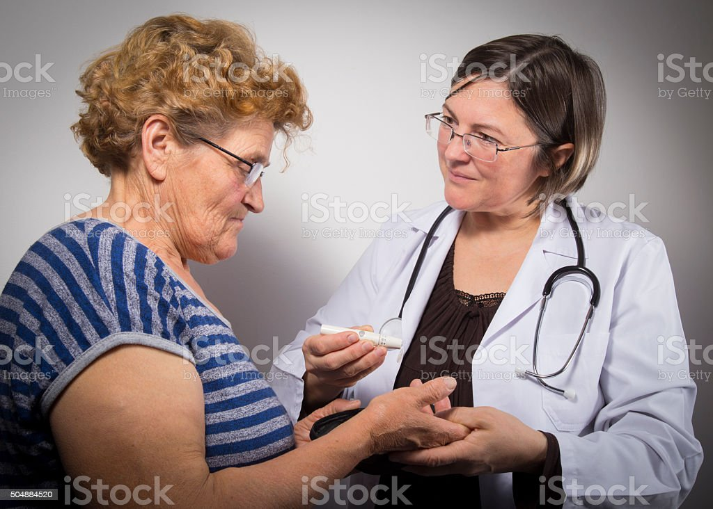 Doctor gives advice on managing diabetes stock photo
