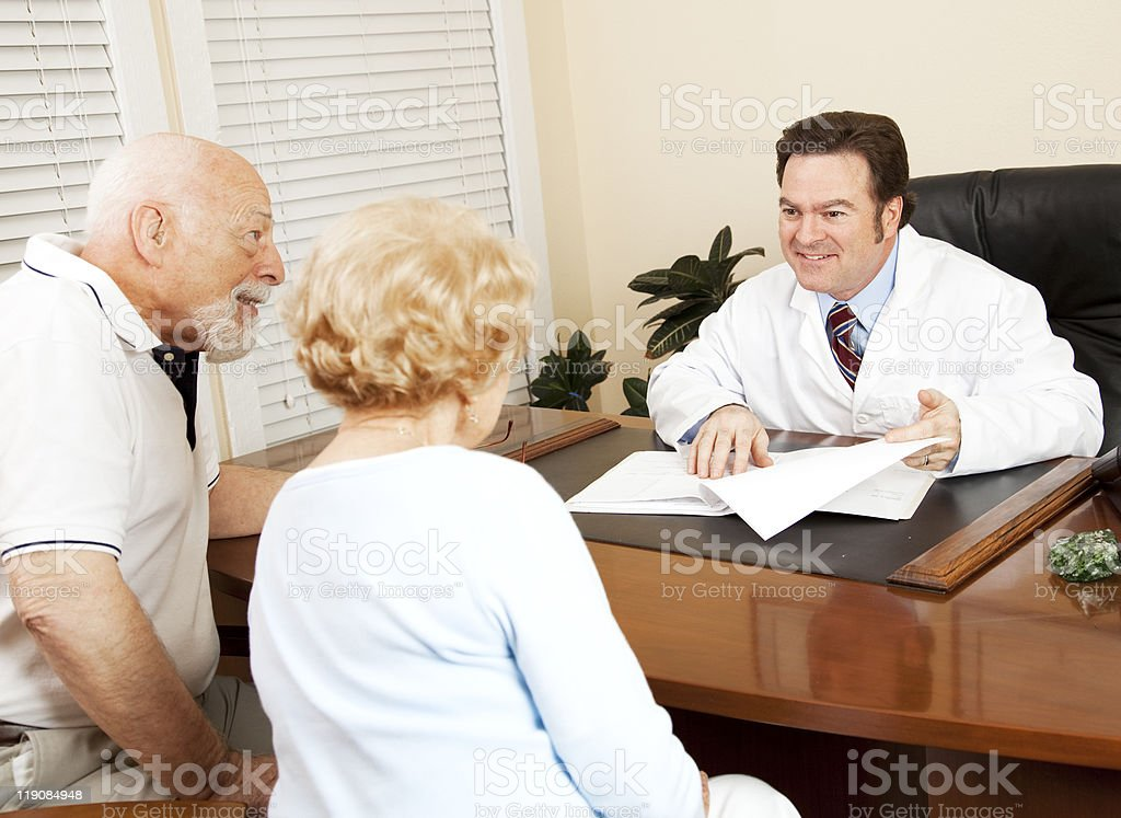 Doctor Gives Good News to Patient royalty-free stock photo