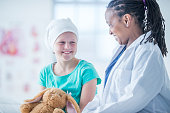 Doctor Giving a Little Girl a Stuffed Animal