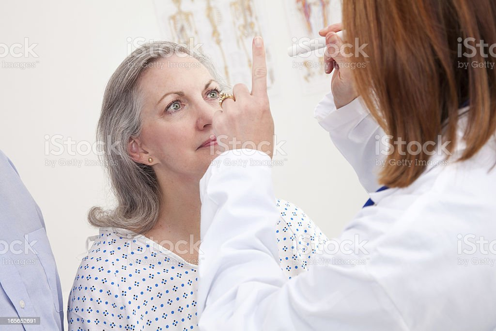 Doctor Giving Exam to Senior Adult Patient royalty-free stock photo