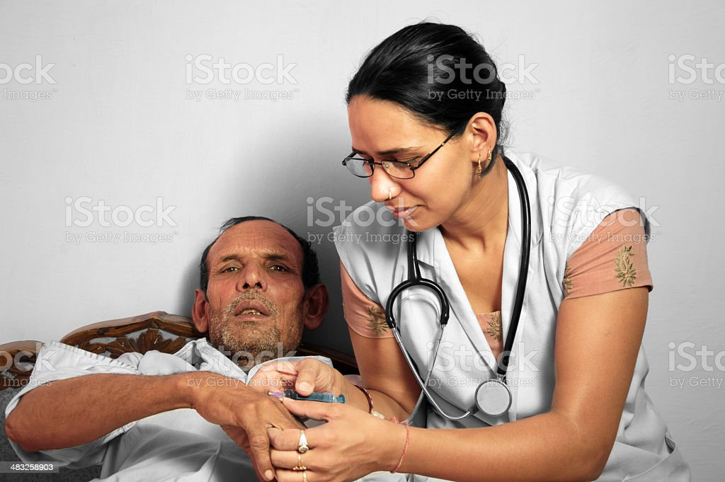 Doctor Giving Injection stock photo