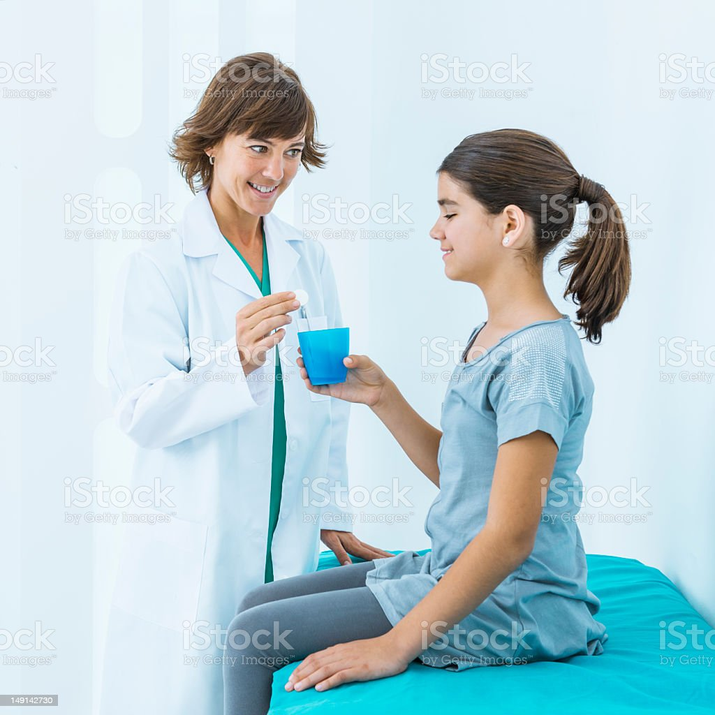 Doctor giving medicine to patient royalty-free stock photo