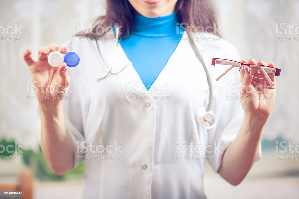 doctor giving pair of contact lens to patient stock photo