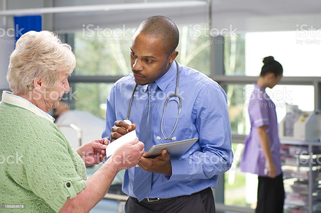 Doctor giving prescription advice stock photo