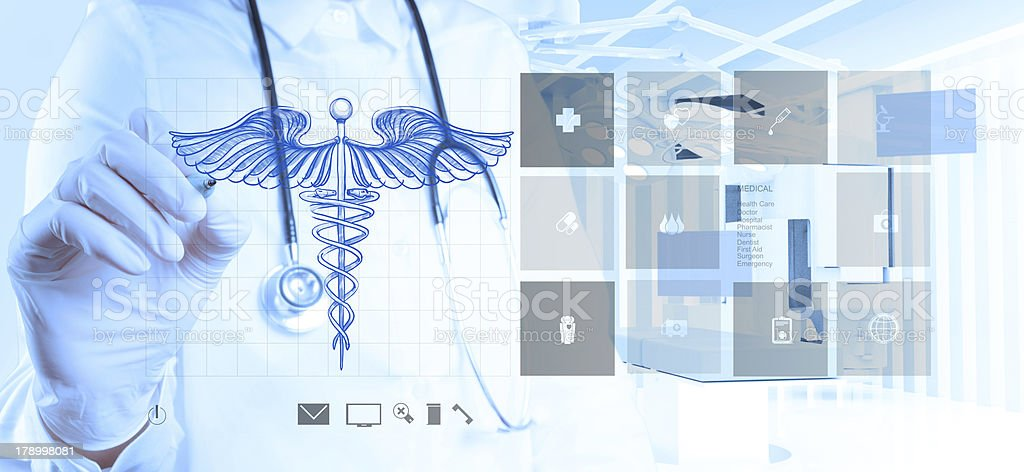 doctor hand draws Caduceus stock photo