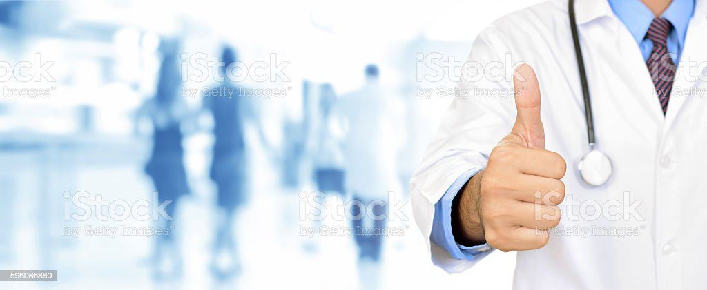 Doctor hand giving thumbs up stock photo
