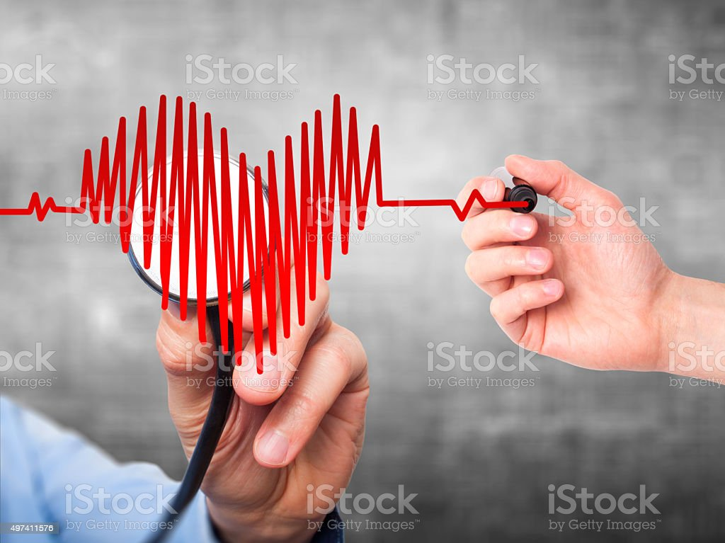 Doctor hand listening to heart beat in heart shape with stethoscope stock photo