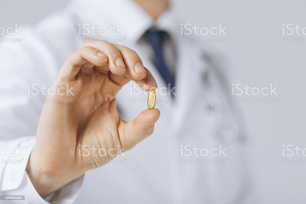doctor hand showing one capsule stock photo