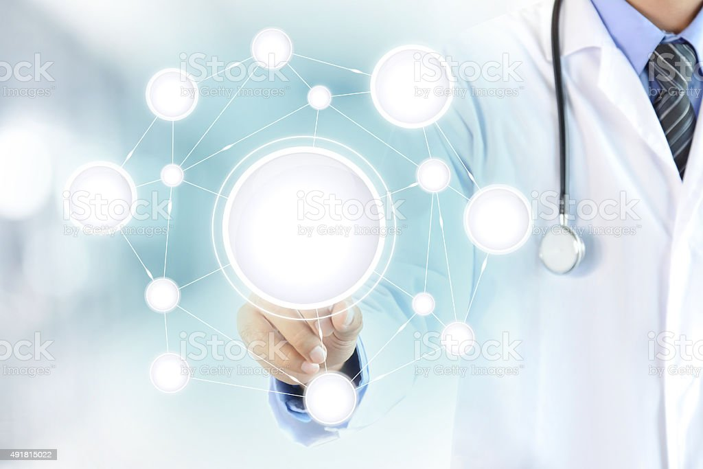 Doctor hand touching blank circle network on virtual screen stock photo