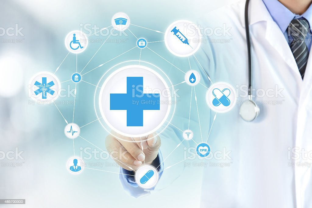Doctor hand touching first aid sign on virtual screen stock photo