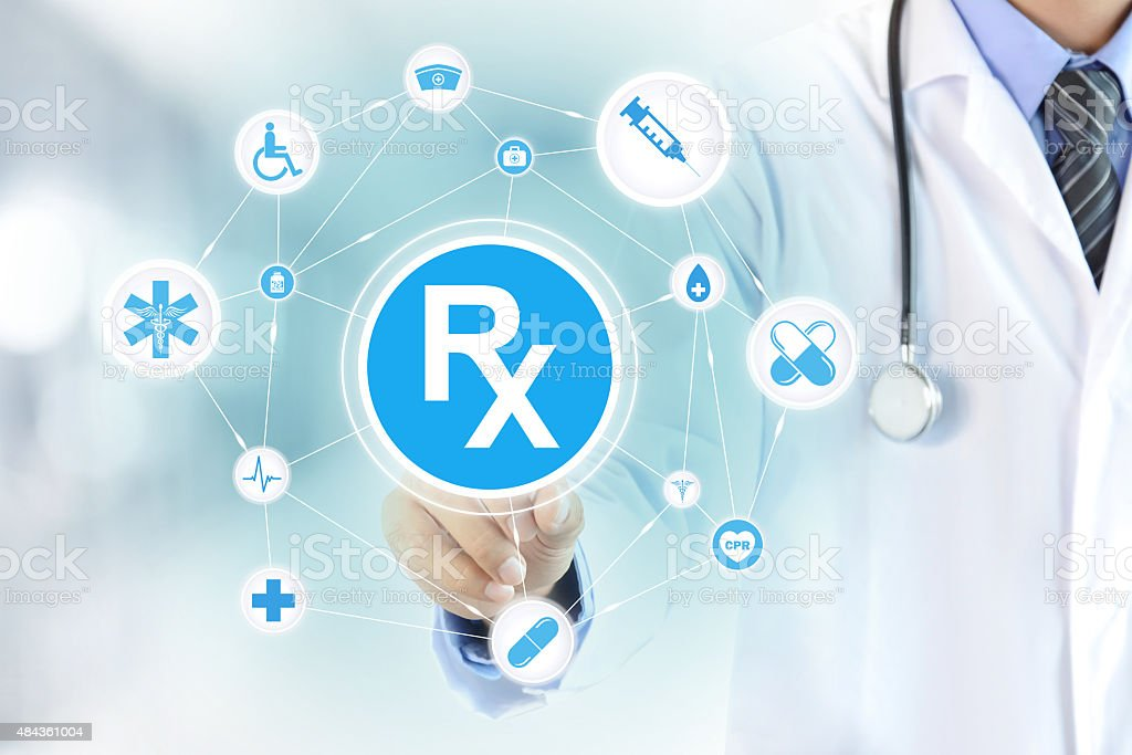 Doctor hand touching Rx sign on virtual screen stock photo