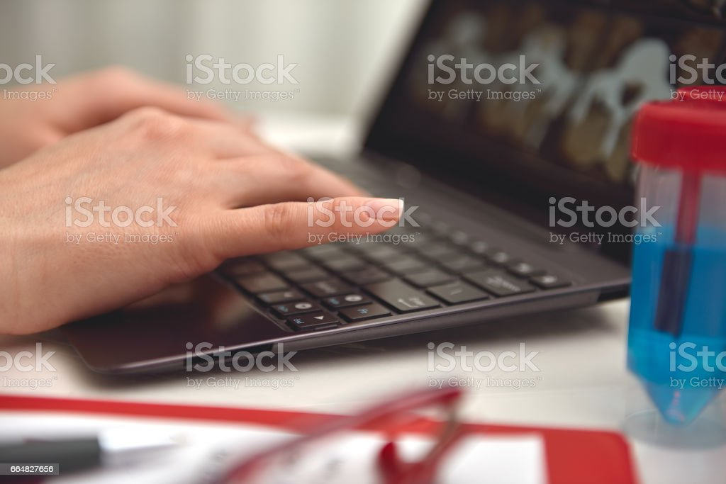doctor hands typing on laptop stock photo