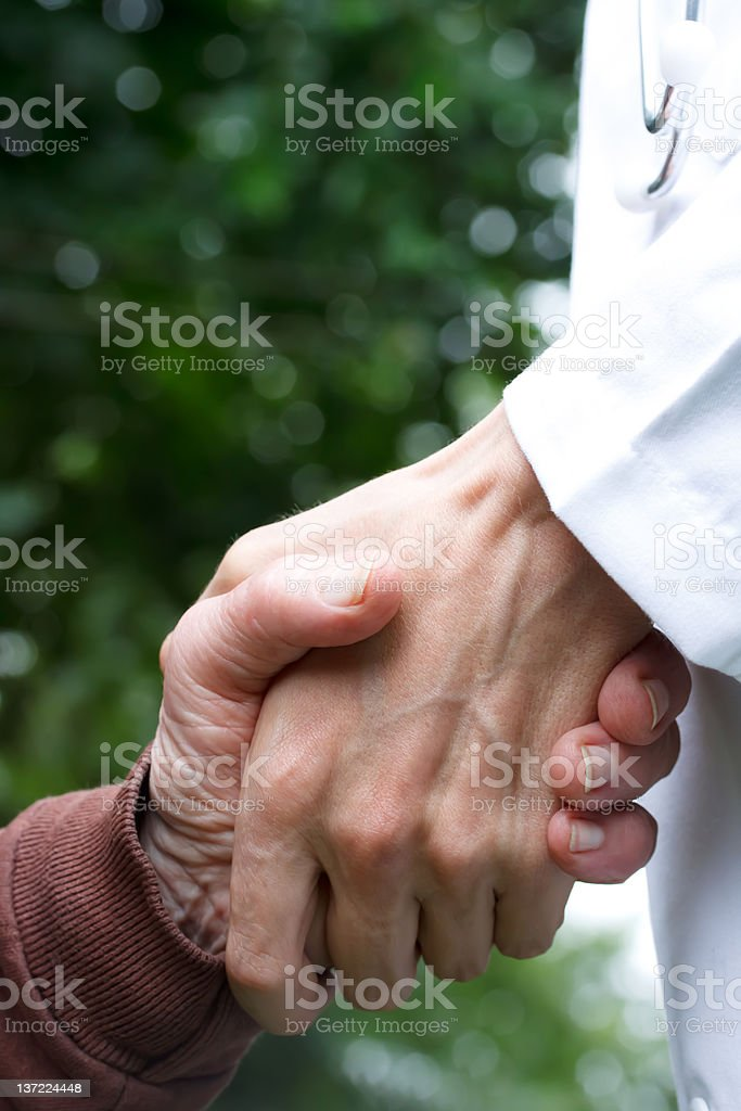 Doctor helping senior lady royalty-free stock photo