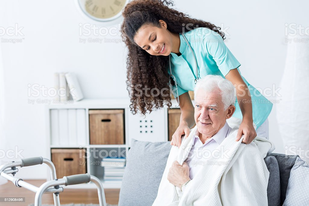 Doctor helping senior man stock photo