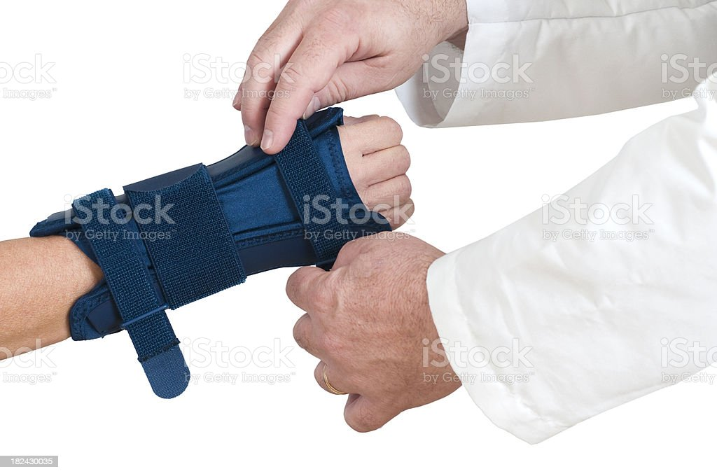 Doctor Helps With Carpal Tunnel Wrist Brace stock photo