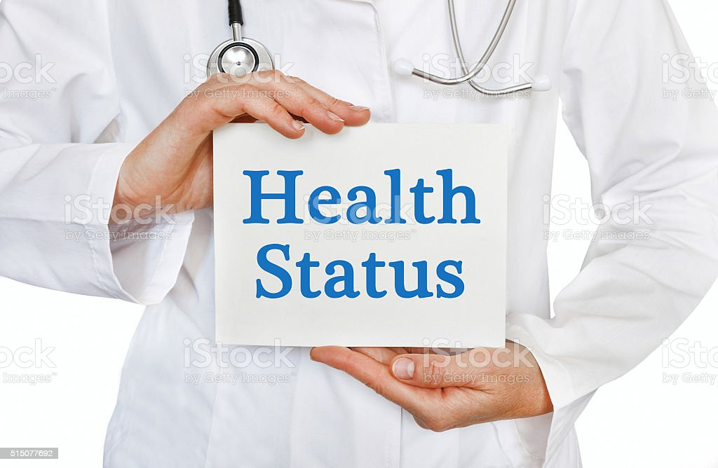 Doctor holding a card with Health Status, Medical concept stock photo