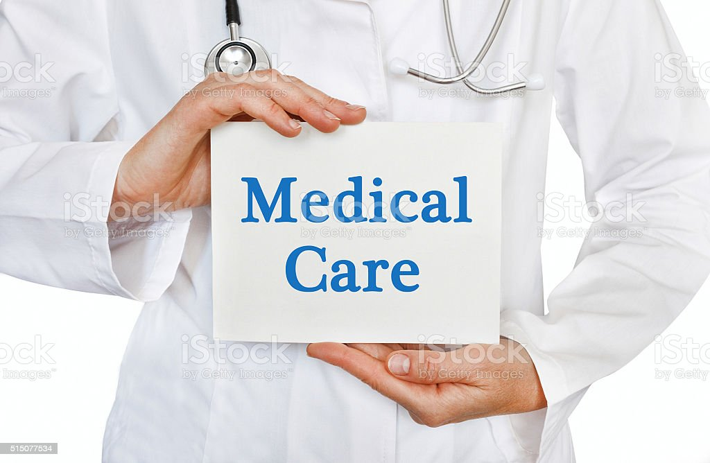 Doctor holding a card with Medical Care, Medical concept stock photo