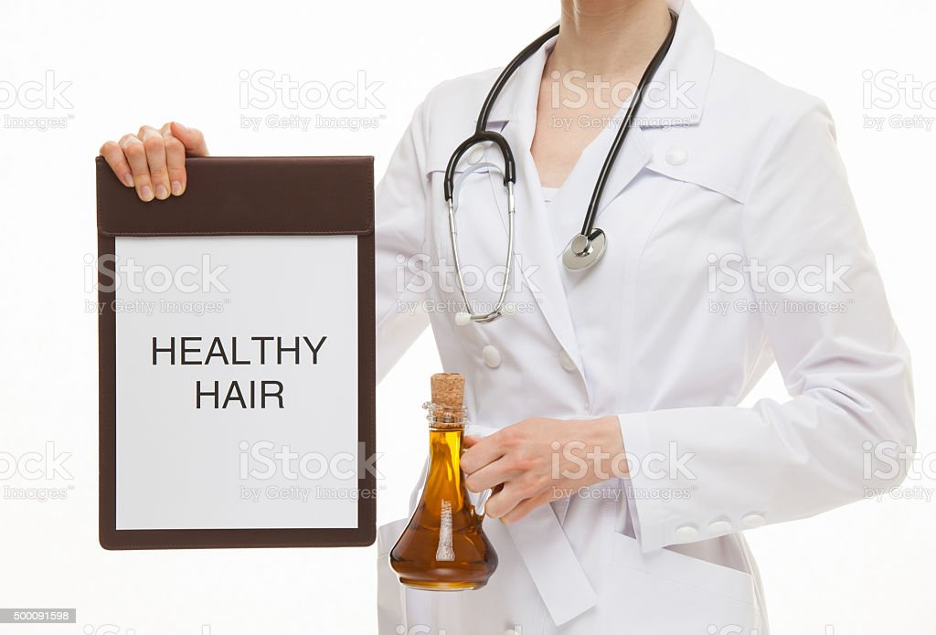 Doctor holding a clipboard with text 'Healthy hair' stock photo
