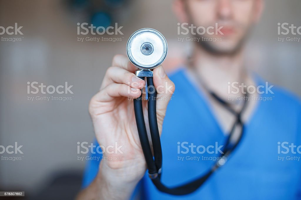 Doctor holding a Phonendoscope in his hand. Checks the health stock photo