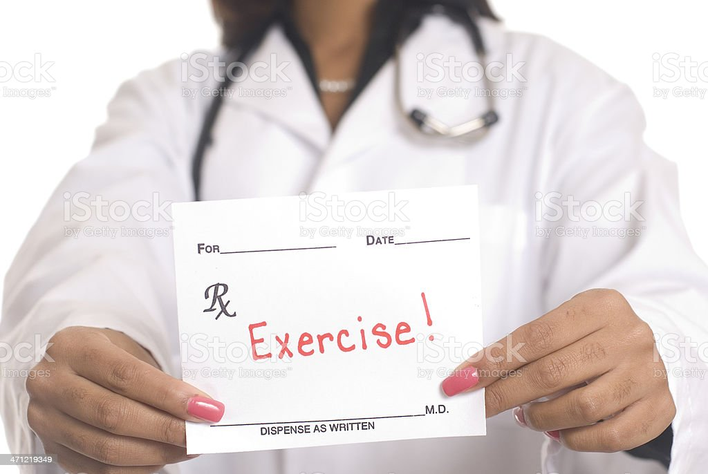 A doctor holding a prescription saying exercise stock photo