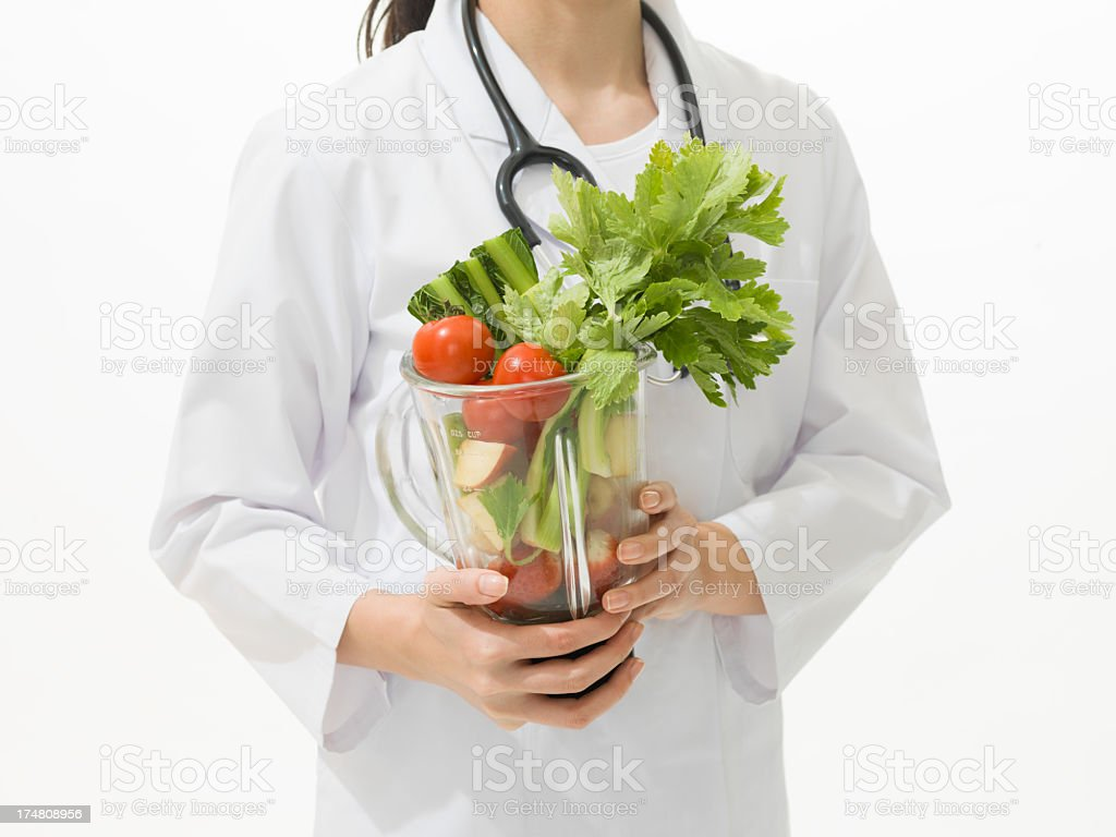Doctor holding a Vegetable juicer stock photo
