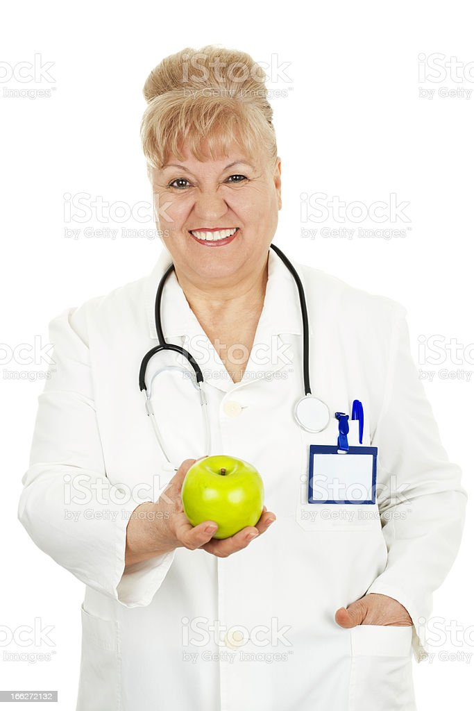 doctor holding an apple royalty-free stock photo