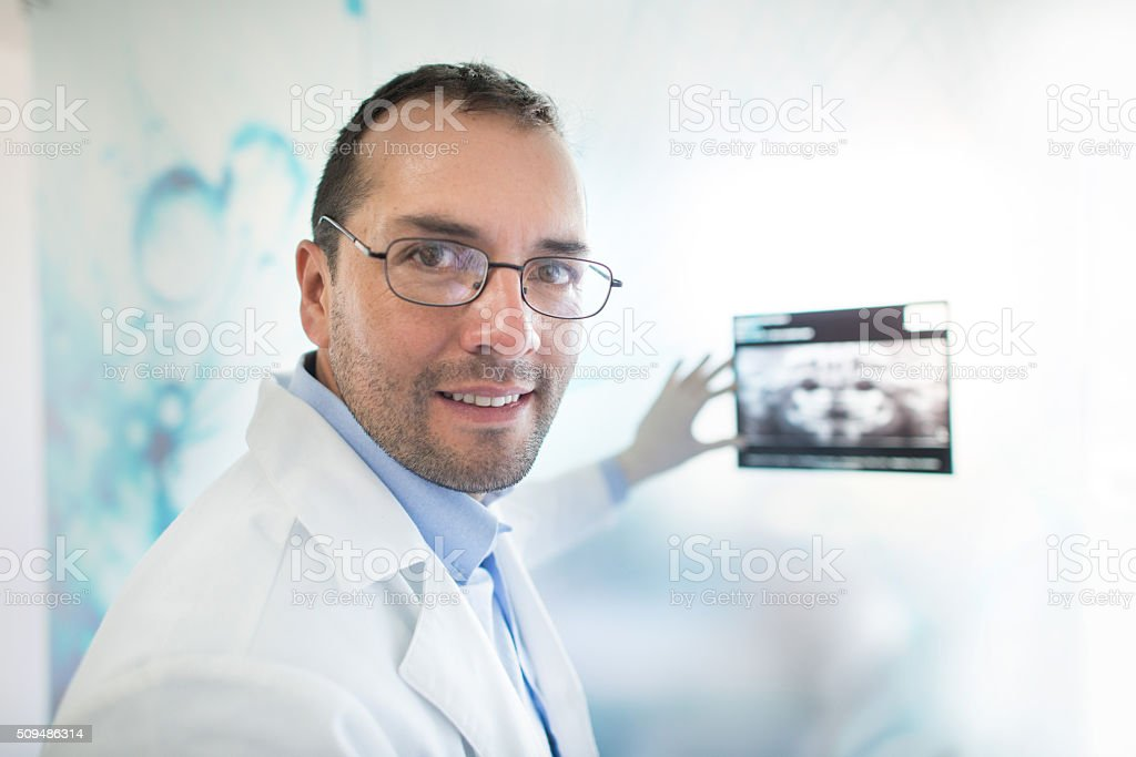 Doctor holding an x-ray stock photo