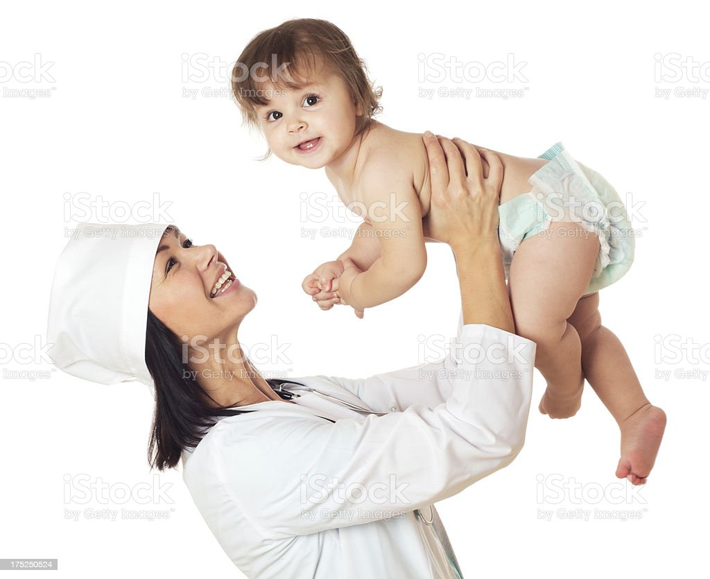 Doctor holding baby over his head. stock photo