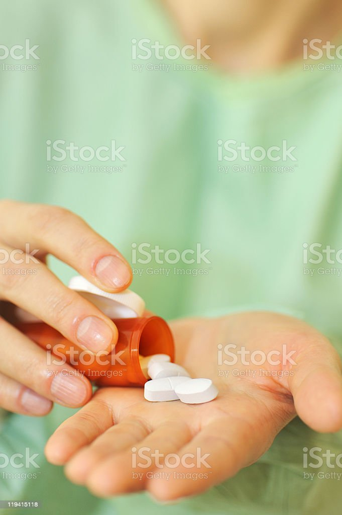 doctor holding bottle of prescription pills royalty-free stock photo