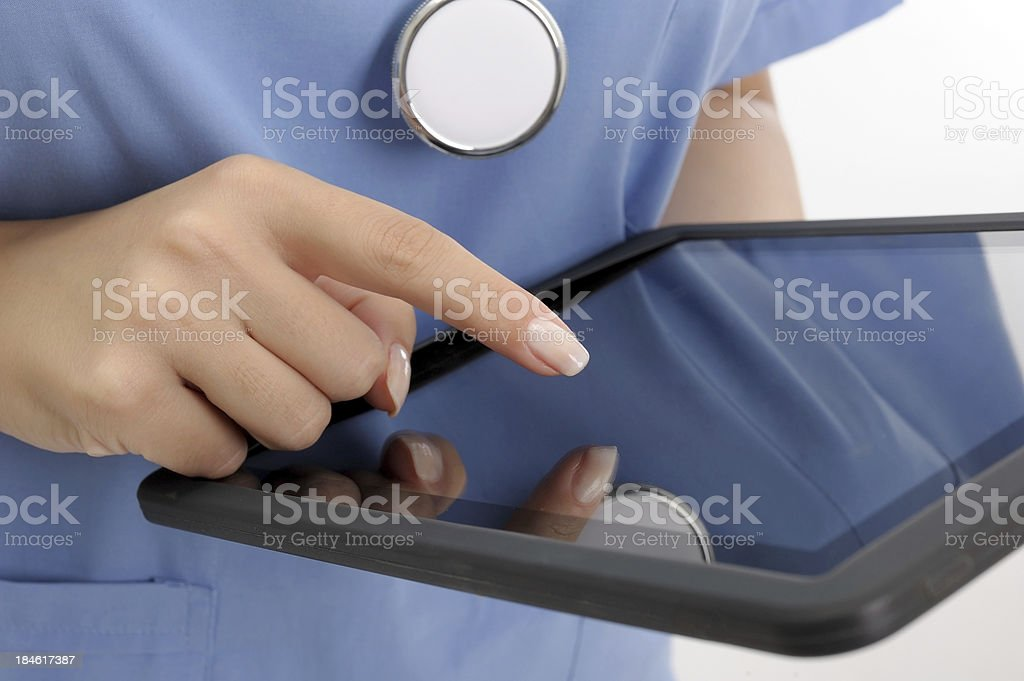 Doctor holding digital tablet royalty-free stock photo