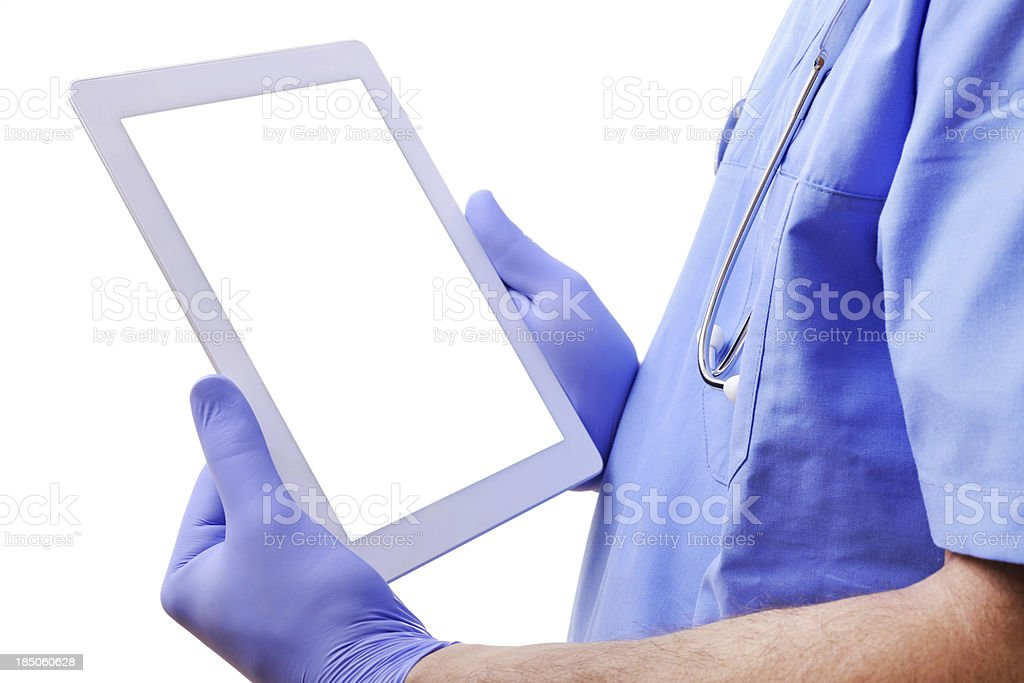 Doctor holding digital tablet stock photo